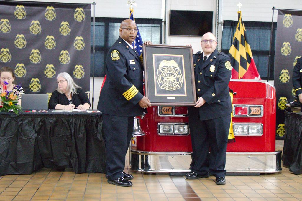 President Jeff Clements on right being presented his pictured SMVFA logo to be displayed proudly throughout his term