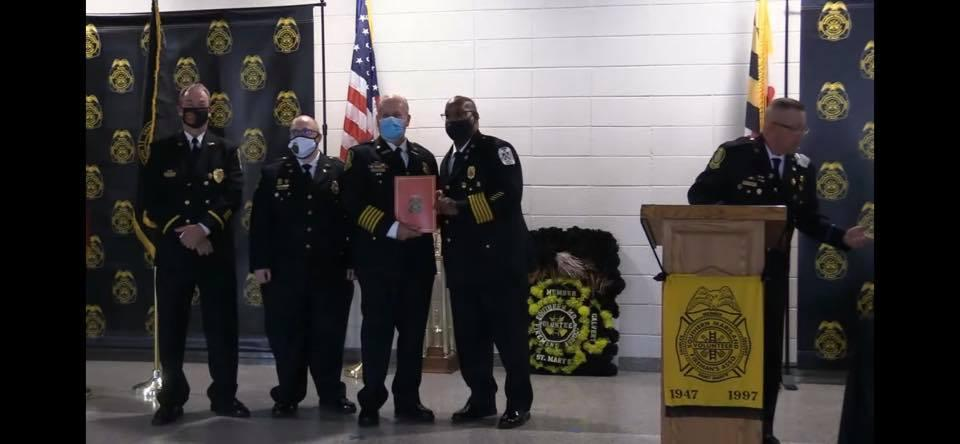 Cobb Island VFD&EMS Past Chief Jimmy Jackson for receives a 50 Years of Service Award during the convention