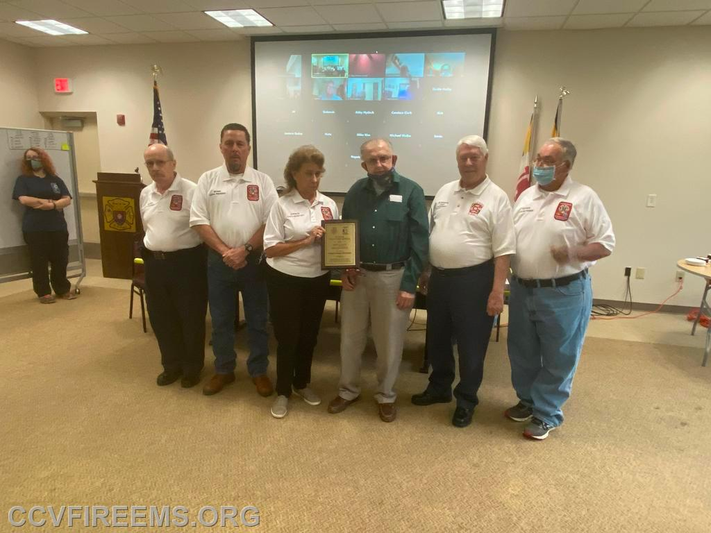 Chaplain Ikel presented with a plaque in honor of his 50 Years Service from CCVFA