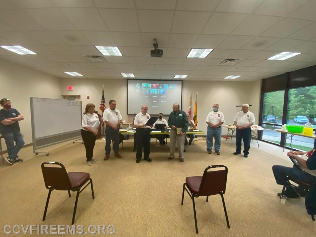 "CCVFA Treasurer Butch Frazier reads ""Certificate of Service"" from BOCC"